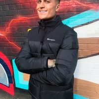 Champion high neck padded jacket in black