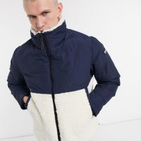 Champion high neck padded jacket in navy and white